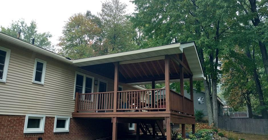 Ground view of the back of a house and deck with new K-Guard leaf free gutters