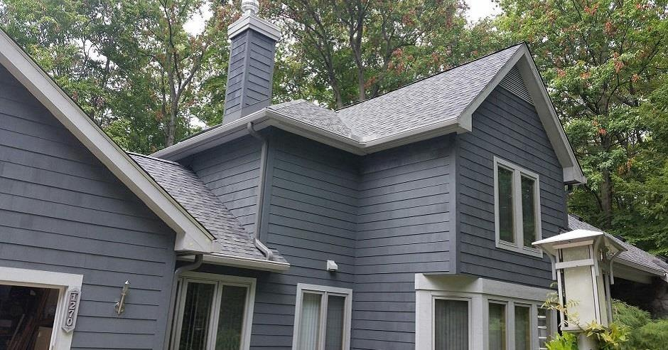 House with blue siding and new K-Guard leaf free gutters