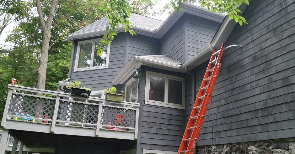 House with blue siding and a white K-Guard Leaf Free Gutter System