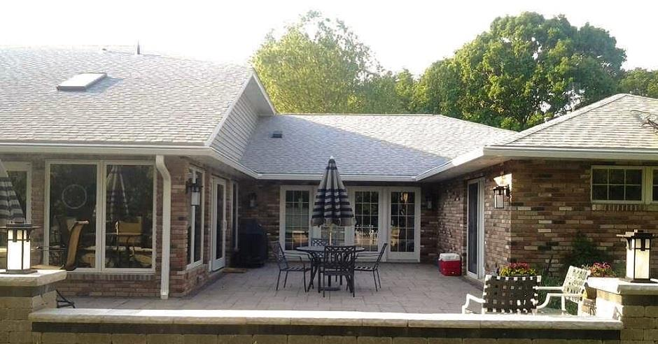 Back view of the patio of a home with new K-Guard leaf free gutters