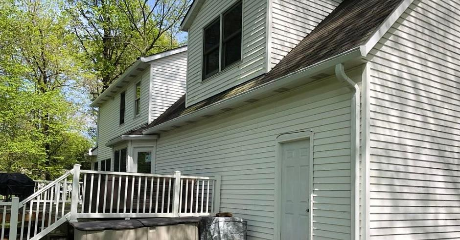 House with white siding and white K-Guard leaf free gutters