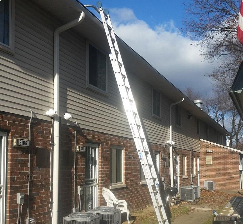 Ladder leaning against an apartment building