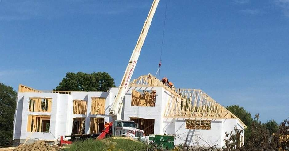 Beginning stages of a roof installation on a house during construction
